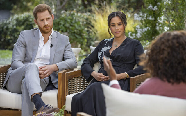 This image provided by Harpo Productions shows Prince Harry and Meghan, Duchess of Sussex, in conversation with Oprah Winfrey in an interview broadcast March 7, 2021. (Joe Pugliese/Harpo Productions via AP, File)