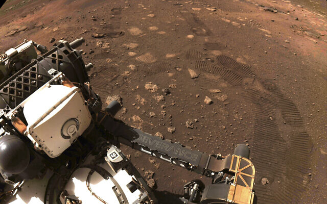 This March 4, 2021 file photo made available by NASA was taken during the first drive of the Perseverance rover on Mars. The Perseverance rover has been on Mars for a month, collecting data and making discoveries with each passing day. (NASA/JPL-Caltech via AP)