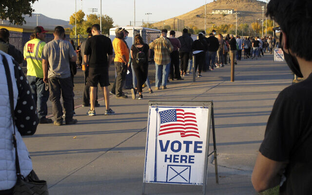 Nevadans wait to vote in-person at Reed High School in Sparks, Nevada, prior to polls closing in the US presidential elections, November 3, 2020.  (Scott Sonner/AP)