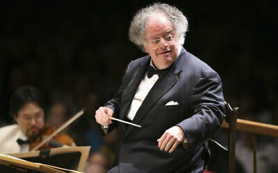 FILE: James Levine conducts the Boston Symphony Orchestra on its opening night performance at Tanglewood in Lenox, Mass. on July 7, 2006. Levine, who ruled over the Metropolitan Opera for 4 1/2 decades before being eased out when his health declined and then fired for sexual improprieties, died March 9, 2021 in Palm Springs, Calif., of natural causes, his physician of 17 years, Dr. Len Horovitz, said Wednesday, March 17. He was 77. (AP Photo/Michael Dwyer, File)
