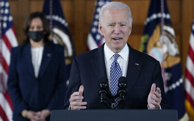 President Joe Biden speaks after meeting with leaders from Georgia's Asian-American and Pacific Islander community, Friday, March 19, 2021, at Emory University in Atlanta, as Vice President Kamala Harris listens. (AP Photo/Patrick Semansky)