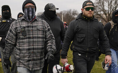 In this Jan. 6, 2021, file photo, Proud Boy members Joseph Biggs, left, and Ethan Nordean, right with megaphone, walk toward the US Capitol in Washington, in support of President Donald Trump. Four men described by prosecutors as leaders of the far-right Proud Boys have been indicted on charges that they planned and carried out a coordinated attack on the US Capitol to stop Congress from certifying President Joe Biden's electoral victory. Nordean and Biggs, two of the four defendants charged in the latest indictment, were arrested several weeks ago on separate but related charges. The new indictment also charges Zachary Rehl and Charles Donohoe.(AP Photo/Carolyn Kaster, File)