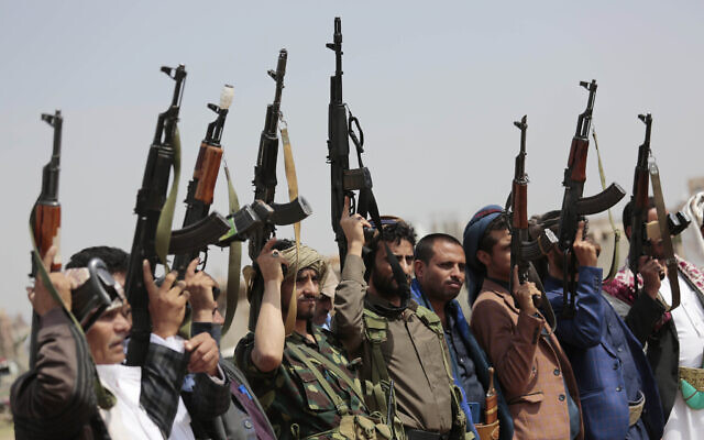 In this Aug. 22, 2020 file photo, tribesmen loyal to Houthi rebels raise their weapons during a protest against the agreement to establish diplomatic relations between Israel and the United Arab Emirates, in Sanaa, Yemen. (AP/Hani Mohammed, File)