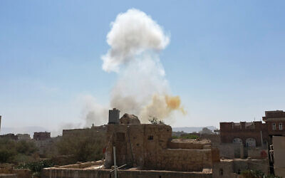 Smoke rises after Saudi-led airstrikes on an army base in Sanaa, Yemen, March 7, 2021. (AP Photo/Hani Mohammed, File)