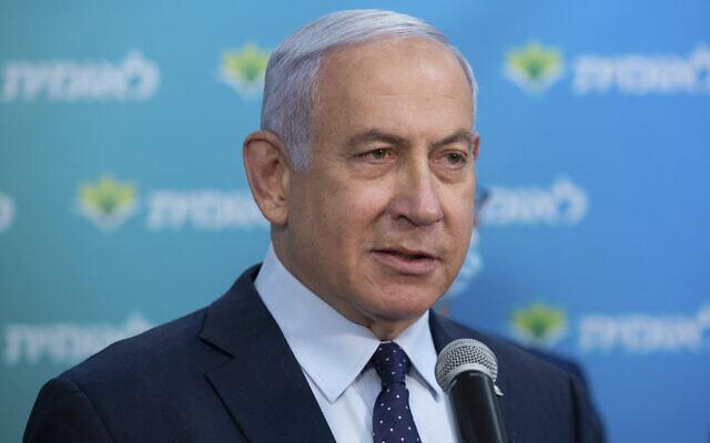 Prime Minister Benjamin Netanyahu visits the Leumit Health Care Services vaccination facility in Jerusalem, February 16, 2021. (Alex Kolomoisky/Pool via AP, File)