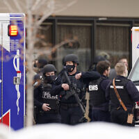 Police work on the scene outside a King Soopers grocery store where a shooting took place Monday, March 23, 2021, in Boulder, Colo. (AP Photo/David Zalubowski)