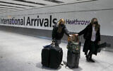 Illustrative photo of travelers arriving at Heathrow Airport in London, January 17, 2021. (AP Photo/Frank Augstein, File)