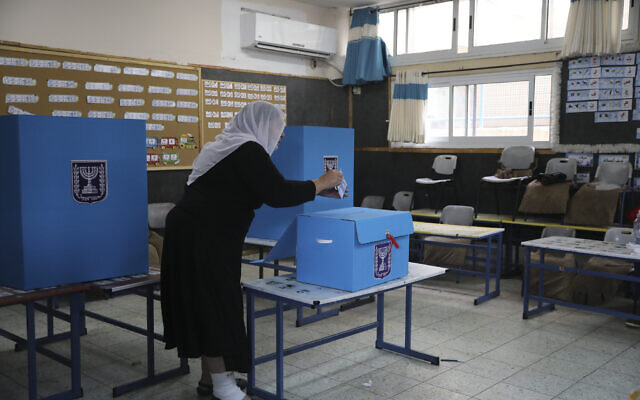 An Arab Israeli woman votes in the Knesset election at a polling station in Maghar, March 23, 2021. (AP Photo/Mahmoud Illean)