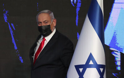 Prime Minister Benjamin Netanyahu arrives to address supporters after the March 23 elections, at his Likud party's election HQ in Jerusalem, early on Wednesday, March. 24, 2021. (AP Photo/Ariel Schalit)