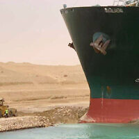 In this photo released by the Suez Canal Authority, a cargo ship, named the Ever Given, sits with its bow stuck into the wall on March 24, 2021, after it become wedged across Egypt's Suez Canal and blocked all traffic in the vital waterway. (Suez Canal Authority via AP)