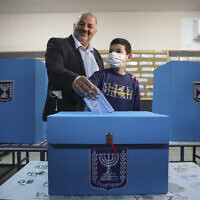 MK Mansour Abbas, leader of Ra'am, votes in Israel's parliamentary election at a polling station in Maghar, Israel, March 23, 2021. (AP Photo/Mahmoud Illean, File)
