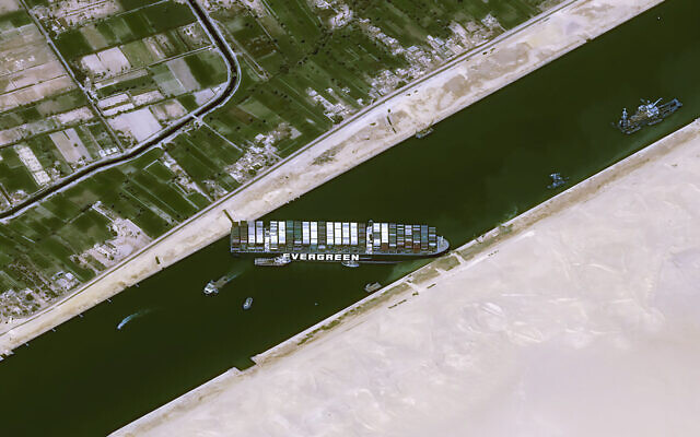 This satellite image from Cnes2021, Distribution Airbus DS, shows the cargo ship MV Ever Given stuck in the Suez Canal near Suez, Egypt, March 25, 2021. (Cnes2021, Distribution Airbus DS via AP)