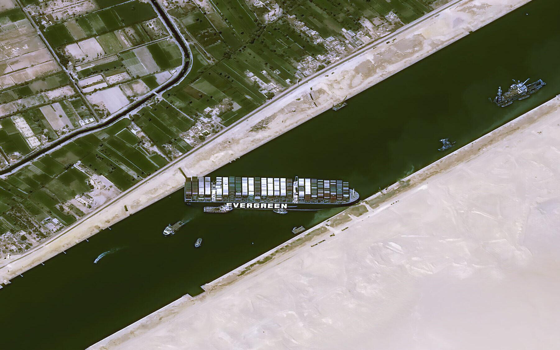 Giant ship blocking Suez Canal like a 'beached whale'