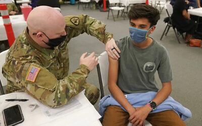 Illustrative: Logan Garnica receives his Pfizer vaccine on March 25, 2021, in Spanish Fork, Utah. (AP Photo/Rick Bowmer)