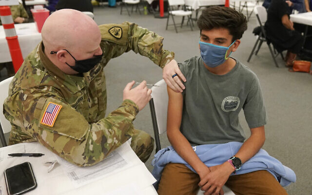 Illustrative: Logan Garnica receives his Pfizer vaccine on March 25, 2021, in Spanish Fork, Utah. (AP Photo/Rick Bowmer)