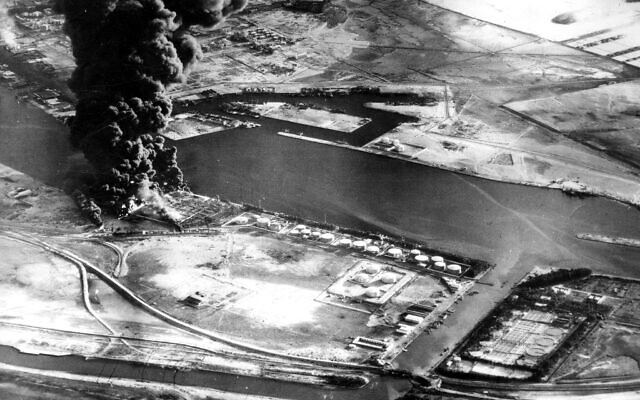 Fuel installations on the Suez Canal burn after an attack by aircraft of the Sea Venom Squadron from HMS Eagle as Britain, France and Israel intervened militarily and occupied the canal zone following Egypt nationalizing the canal, November 11, 1956. (AP Photo, File)