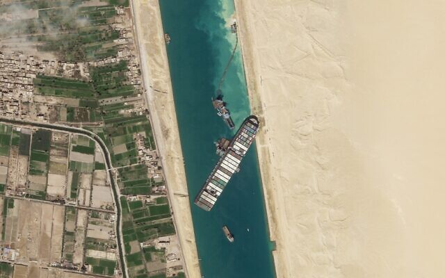 FILE - In this March 28, 2021, satellite file image from Planet Labs Inc, the cargo ship MV Ever Given sits stuck in the Suez Canal near Suez, Egypt. (Planet Labs Inc. via AP)