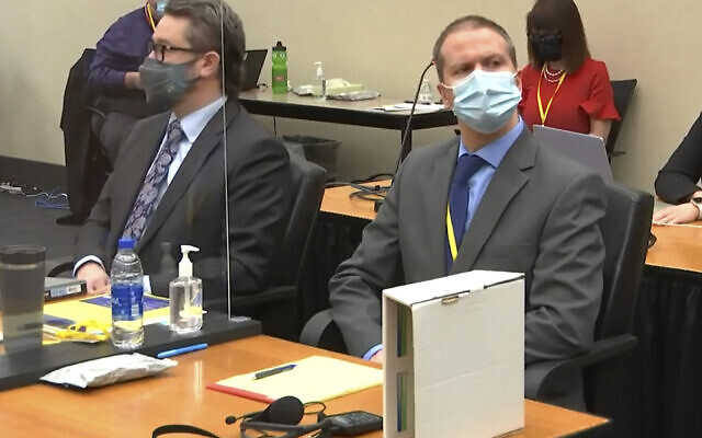 In this image from video, defense attorney Eric Nelson, left, and former Minneapolis police officer Derek Chauvin listen as Hennepin County Judge PeterCahill presides over pre-trial motions prior to opening statements, March 29, 2021, in the trial of Chauvin in the May 25, 2020, death of George Floyd at the Hennepin County Courthouse in Minneapolis, Minnessota. (Court TV via AP, Pool)