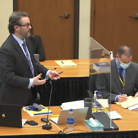 In this image from video, defense attorney Eric Nelson, left, accompanied by former Minneapolis police officer Derek Chauvin speaks as Hennepin County Judge PeterCahill presides Monday, March 29, 2021, in the trial of Chauvin, in the May 25, 2020, death of George Floyd at the Hennepin County Courthouse in Minneapolis, Minnesota. (Court TV via AP, Pool)