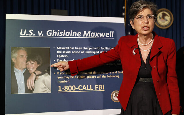 Audrey Strauss, acting United States Attorney for the Southern District of New York, points to a photo of Jeffrey Epstein and his ex-girlfriend Ghislaine Maxwell, July 2, 2020. (AP Photo/John Minchillo, File)