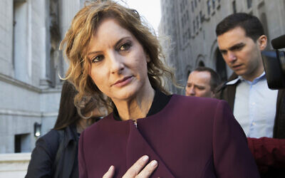 """In this October 18, 2018 file photo, former """"Apprentice"""" contestant Summer Zervos leaves New York state appellate court in New York. (AP Photo/Mary Altaffer, File)"""