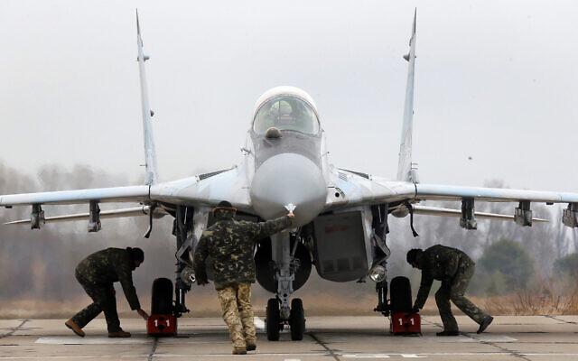 A Ukrainian MIG-29 fighter jet is parked at the Vasilkov air base outside outside Kiev, Ukraine, November 23, 2016. (Efrem Lukatsky/AP)