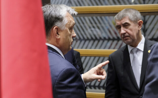 Hungarian Prime Minister Viktor Orban, left, speaks with Czech Republic's Prime Minister Andrej Babis during a meeting of the Visegrad Group on the sidelines of an EU summit in Brussels on Dec. 14, 2017. (Olivier Hoslet, Pool Photo via AP)
