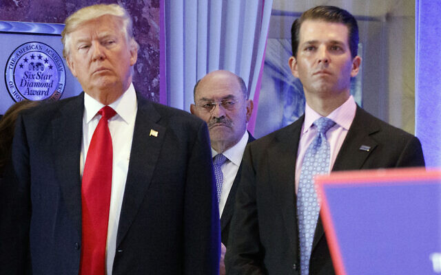 In this Jan. 11, 2017 file photo, Allen Weisselberg, center, is seen between President-elect Donald Trump, left, and Donald Trump Jr., at a news conference in the lobby of Trump Tower in New York.  (AP Photo/Evan Vucci, File)
