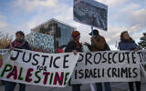 Demonstrators carry banners outside the International Criminal Court, ICC, rear, urging the court to prosecute Israel's army for alleged war crimes in The Hague on Nov. 29, 2019. (AP/Peter Dejong)