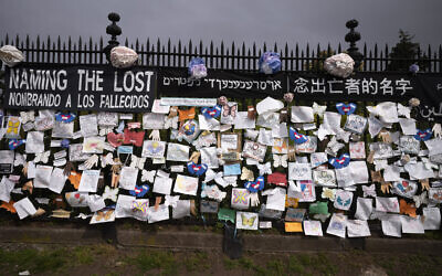 A fence outside Brooklyn's Green-Wood Cemetery is adorned with tributes to victims of COVID-19 in New York,  May 28, 2020. (Mark Lennihan/AP)