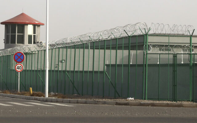 FILE: A guard tower and barbed wire fence surround a detention facility in the Kunshan Industrial Park in Artux in western China's Xinjiang region. The Associated Press found that the Chinese government was carrying out a birth control program aimed at Uighurs, Kazakhs and other largely Muslim minorities in Xinjiang, even as some of the country's Han majority was encouraged to have more children. The measures included detention in prisons and camps, such as this facility in Artux, as punishment for having too many children, Dec. 3, 2018. (AP Photo/Ng Han Guan, File)