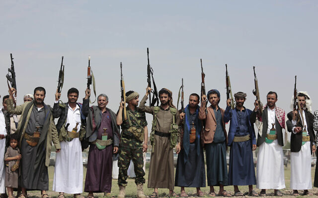 Illustrative: Tribesmen loyal to Houthi rebels raise their weapons during a gathering against the agreement to establish diplomatic relations between Israel and the United Arab Emirates in Sanaa, Yemen, Saturday, Aug. 22, 2020. (AP Photo/Hani Mohammed)