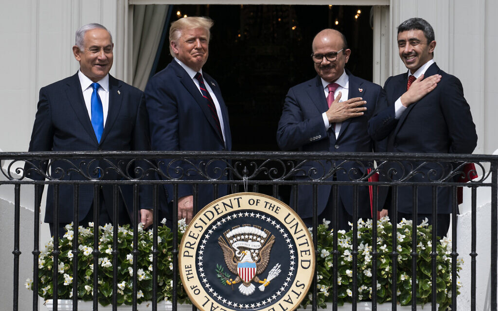 FILE - In this Tuesday, Sept. 15, 2020 file photo, Israeli Prime Minister Benjamin Netanyahu, left, then-US President Donald Trump, Bahrain Foreign Minister Khalid bin Ahmed Al Khalifa and United Arab Emirates Foreign Minister Abdullah bin Zayed al-Nahyan react on the Blue Room Balcony after signing the Abraham Accords during a ceremony on the South Lawn of the White House in Washington. (AP Photo/Alex Brandon)