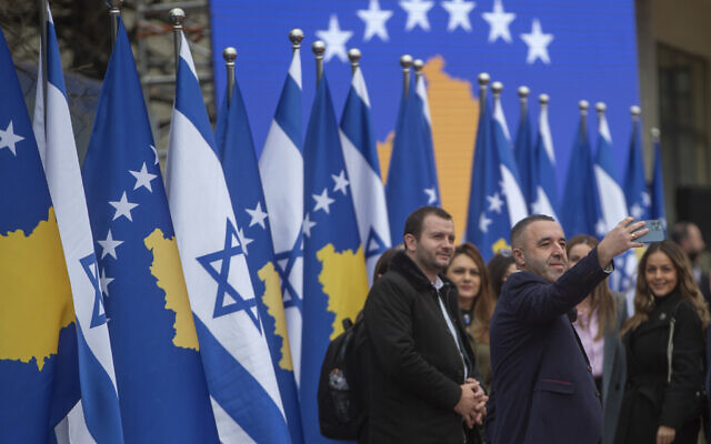 Illustrative: A Kosovo government official takes a self-photo during a signing ceremony held digitally, in the capital Pristina, establishing diplomatic ties between Kosovo and Israel, February 1, 2021. (AP Photo/Visar Kryeziu)