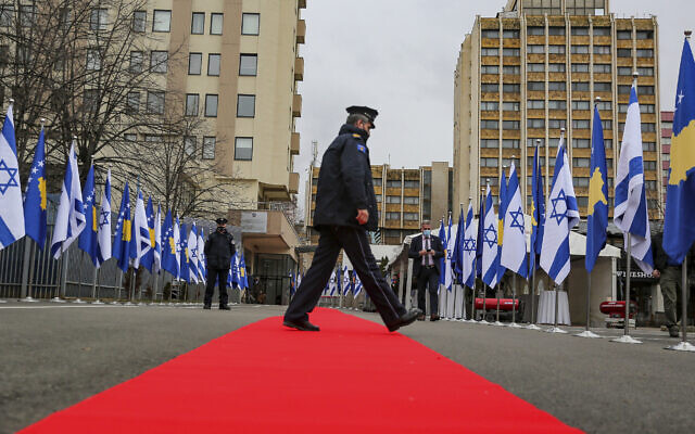 Illustrative: A Kosovo police officer walks across a red carpet prior to a ceremony held digitally, in the capital Pristina, Monday, Feb. 1, 2021. Kosovo and Israel formally have established diplomatic ties in a ceremony held digitally due to the pandemic lockdown. (AP Photo/Visar Kryeziu)