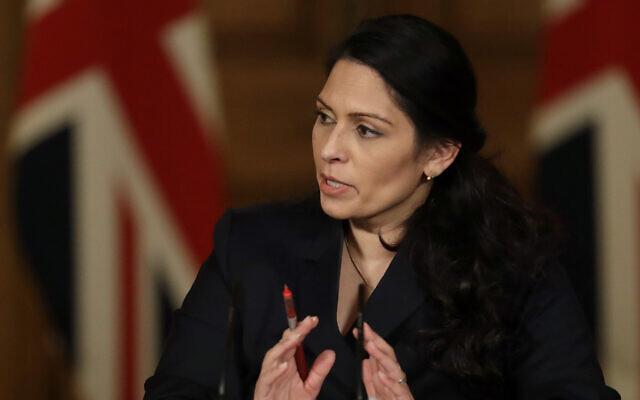 Britain's Home Secretary Priti Patel speaks about the COVID-19 pandemic in Downing Street, London, January 21, 2021. (Matt Dunham/ap)