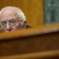 Senate Budget Committee Chairman Sen. Bernie Sanders, I-Vt., listens during a hearing on Capitol Hill in Washington on February 25, 2021, examining wages at large profitable corporations. (AP Photo/Susan Walsh, Pool)