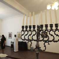 In this Oct. 18, 2020 file photo, a menorah used during the Jewish holiday of Hanukkah, is seen during a visit by an Israeli delegation to the Jewish Community Synagogue of Bahrain, in Manama, Bahrain (Ronen Zvulun/Pool Photo via AP)