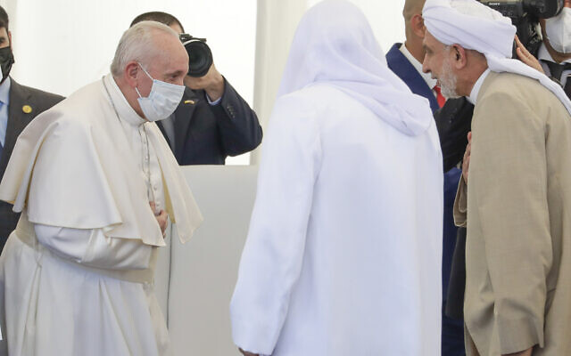 Pope Francis , left, arrives at an interreligious meeting near the archaeological area of the Sumerian city-state of Ur, 20 kilometers south-west of Nasiriyah, Iraq, Saturday, March 6, 2021 (AP Photo/Andrew Medichini)
