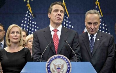In this Dec. 3, 2012, file photo, New York Gov. Andrew Cuomo is joined by the New York Congressional delegation including Sen. Kirsten Gillibrand, left, and Sen. Charles Schumer, right, for a news conference at the Capitol in Washington (AP Photo/J. Scott Applewhite, File)