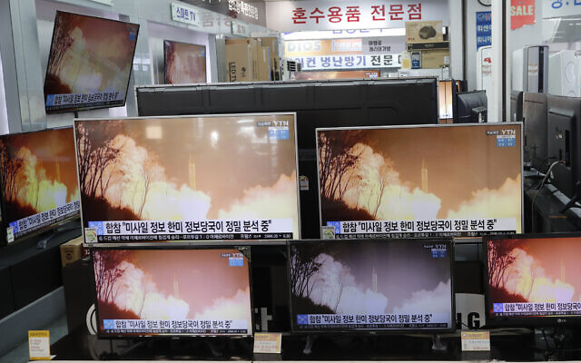 TV screens showing a news program reporting about North Korea's missiles with file footage at an electronic shop in Seoul, South Korea, March 25, 2021 (AP Photo/Lee Jin-man)