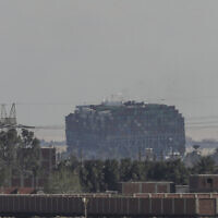 Ever Given, a Panama-flagged cargo ship that is wedged across the Suez Canal and blocking traffic in the vital waterway is seen March 29, 2021 (AP Photo/Mohamed Elshahed)