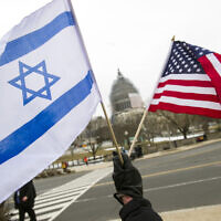 A pro-Israel demonstrator waves flags toward the Capitol in Washington, March 3, 2015. (AP Photo/Cliff Owen)