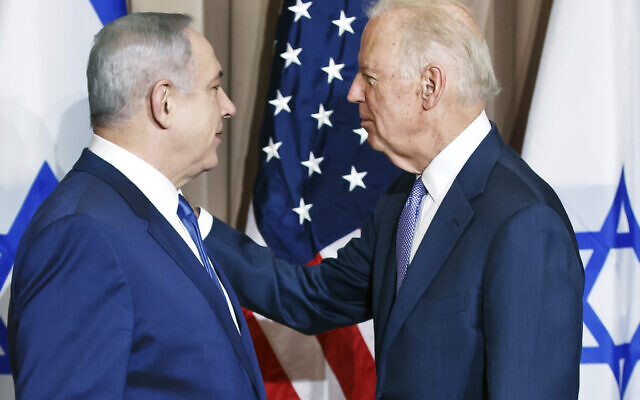 Israeli Prime Minister Benjamin Netanyahu, left, and US Vice-President Joe Biden speak in front of media prior to a meeting on the sidelines of the World Economic Forum in Davos, Switzerland on Jan. 21, 2016. (AP Photo/Michel Euler)