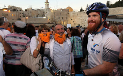 Israeli cyclist Roei Sadan with friends and family members in the Old City of Jerusalem, September 14, 2011, after completing a worldwide bike tour that spanned 1,458 days, 42 countries, 6 continents and 66,000 kilometers. (Kobi Gideon/Flash90)