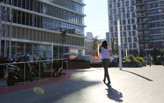 Illustrative: A woman walking toward a building at the Bnei Brak Business Center on October 23, 2017. Yaakov Naumi/FLASH90)
