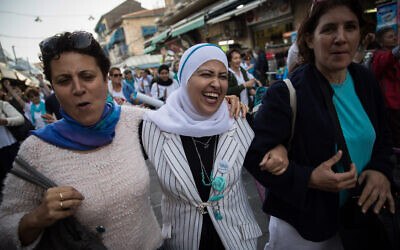 FILE: Hundreds of members from the 'Women Wage Peace' do a flash mob dance at the Mahane Yehuda Market in Jerusalem, during a demonstration calling for peace on International Women's Day, March 6, 2018. (Hadas Parush/Flash90)