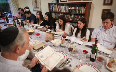 An Israeli family seen during the Passover Seder on the first night of the 8-day long holiday, in Rishon Lezion, March 30, 2018. (Nati Shohat/Flash90/File)