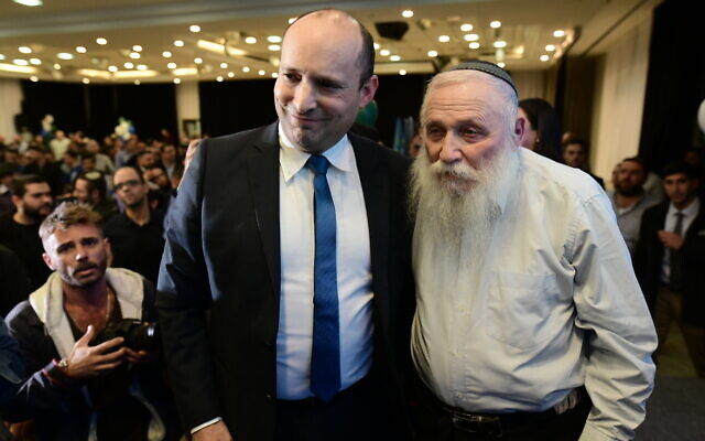 Rabbi Chaim Druckman, right and MK Naftali Bennett attend the campaign launch of the right-wing Yamina party, February 12, 2020. (Tomer Neuberg/FLASH90)