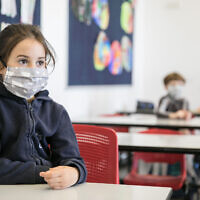 Israeli students wear protective face masks as they return to school on May 3, 2020, in Jerusalem. (Olivier Fitoussi/Flash90)